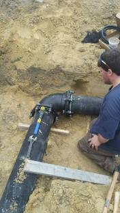 "Jonathan installing a commercial 8"" ductile iron storm water pipe"